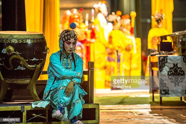 Huadan actress waits behind the curtain Peking opera or Beijing opera is a form of traditional Chinese theater which incorporates singing reciting...