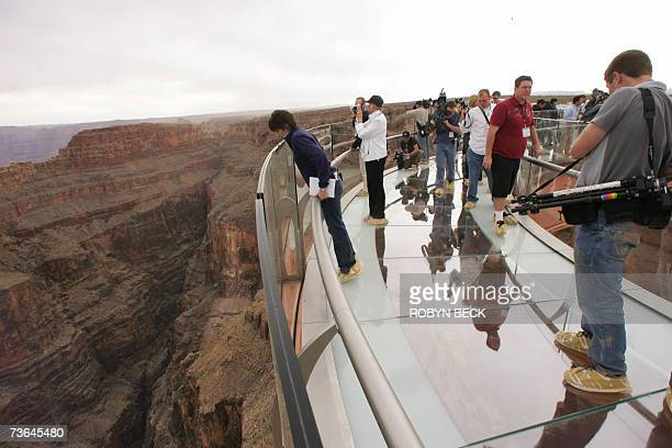 Hualapai Indian Reservation UNITED STATES The first wave of media visitors walk out onto the Skywalk at Grand Canyon West following the opening...