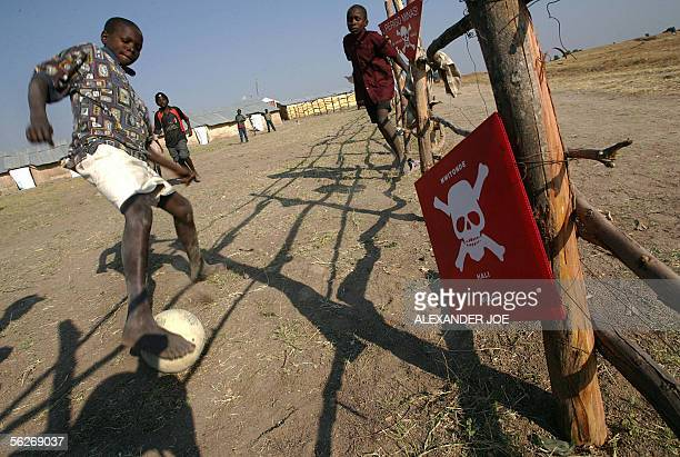 TO GO WITH AFP STORY A file photo taken 07 July 2005 shows Angolan returnee children playing in a Huambo transit camp for refugees from Zambia Armed...