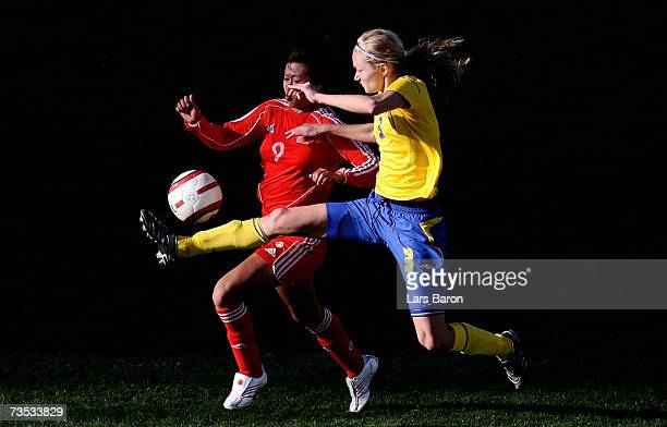 Huan Duan of China in action with Stina Segerstroem of Sweden during the Algarve Cup match between Sweden and China on March 9, 2007 in Faro,...