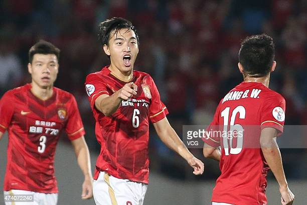 Huang Bowen of Guangzhou Evergrande celebrates with team mates after scoring his team's first goal during the AFC Champions League Round of 16 match...
