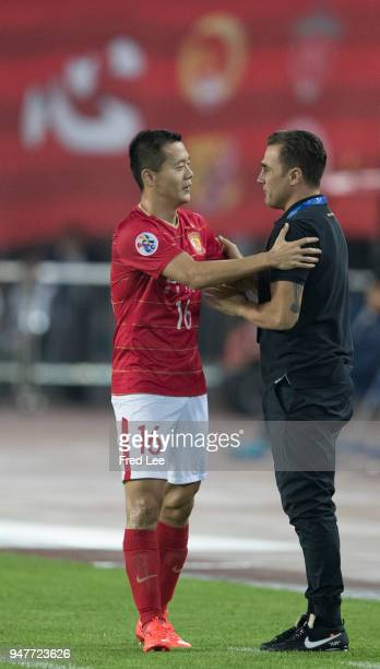 Huang bowen of Guangzhou Evergrande Taobao celebrates with Porto's head coach Fabio Cannavaro after scoring during the 2018 AFC Champions League...