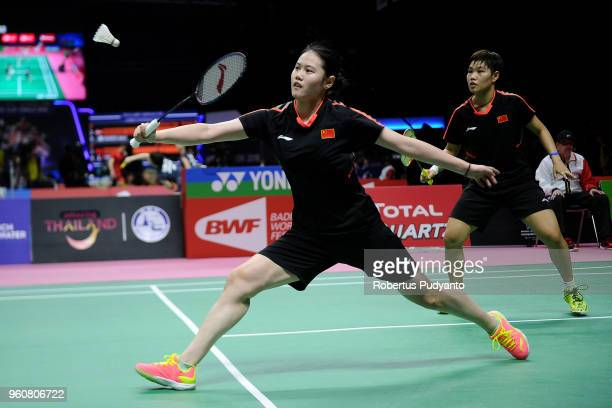 Huang Dongping and Yu Zheng of China compete against Emilie Lefel and Anne Tran of France during Preliminary Round on day two of the BWF Thomas Uber...