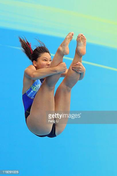 Huang En Tien of Chinese Taipei competes in the Women's 1m Springboard preliminary round during Day Two of the 14th FINA World Championships at the...