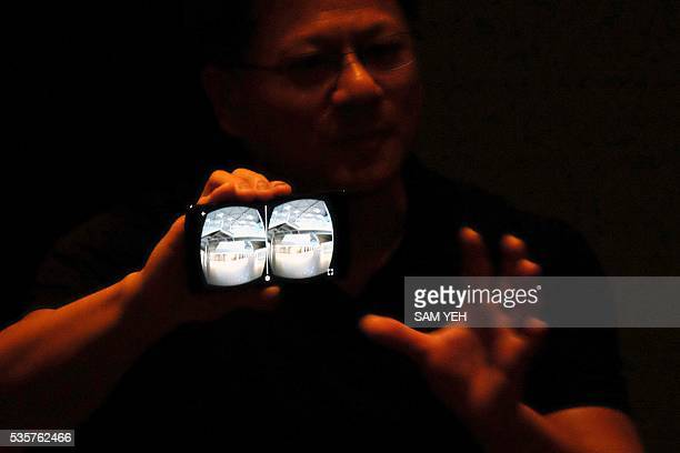 Huang Jenhsun President and Chief Executive Officer of NVIDIA displays a smartphone with Visual Reality technology during a press conference on the...