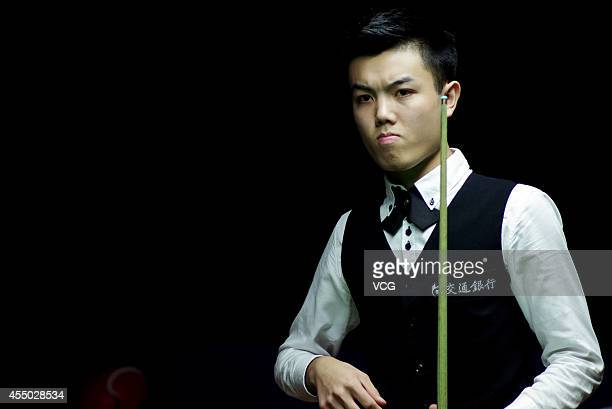 Huang Jiajie of China looks on in the match against Ken Doherty of Ireland during day two of the World Snooker Bank of Communications OTO Shanghai...