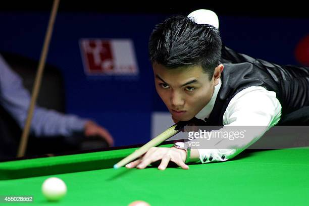 Huang Jiajie of China plays a shot in the match against Ken Doherty of Ireland during day two of the World Snooker Bank of Communications OTO...