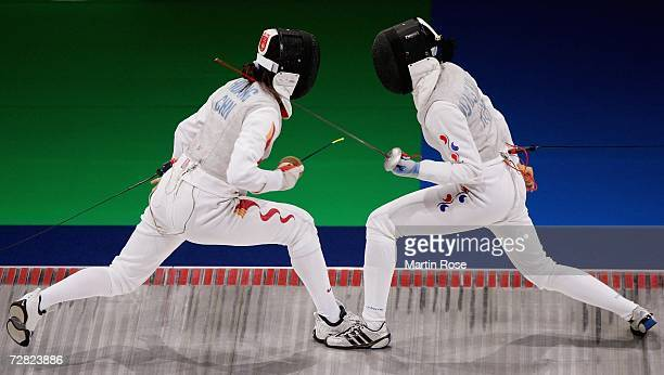 Huang Jialing of China competes with Huang Jialing of Republic of Korea in the Women's Team Foil Gold Medal match during the 15th Asian Games Doha...