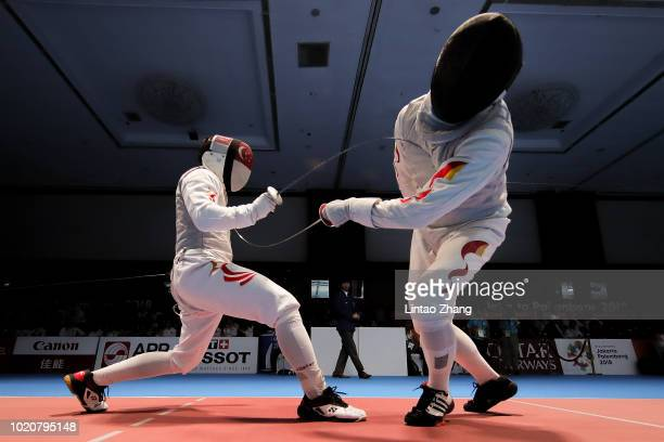Huang Mengkai of China competes against Kevin Jerrold Chan of Singapore during the Men's Foil Individual Quarterfinals of fencing event on day three...
