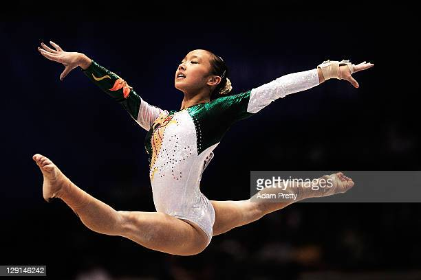 Huang Qiushuang of China competes on the Floor aparatus of the Women's All Around Final during day seven of the Artistic Gymnastics World...