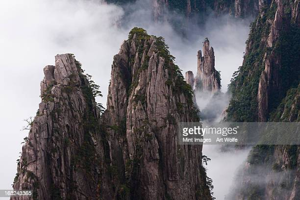Huang Shan, which means Yellow Mountain. Anhui Province in China. Jagged rock towers.