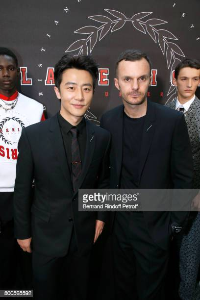 Huang Xuan and Stylist Kris Van Assche pose Backstage after the Dior Homme Menswear Spring/Summer 2018 show as part of Paris Fashion Week on June 24...