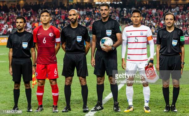 Huang Yang of Hong Kong and Soeuy Visal of Cambodia poses for photos among referees prior to the FIFA World Cup Asian Qualifier second round match...