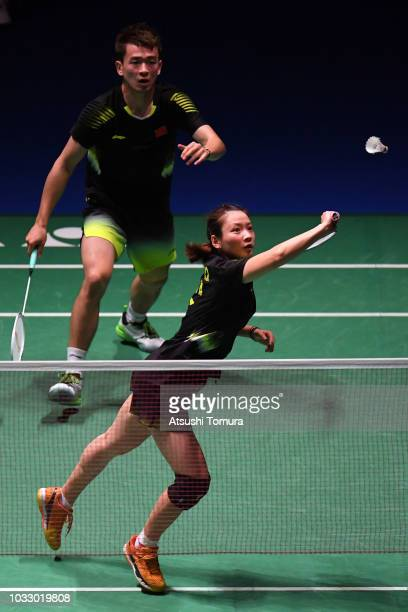 Huang Yaqiong and Zheng Siwei of China compete in the Mix Doubles quarter final match against Li Yinhui and Zhang Nan of China on day four of the...