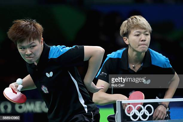 Huang YiHua and Chen SzuYu of Chinese Taipei play a shot against Hong Kong during the Womens' Team Round 1 on Day 7 of the Rio 2016 Olympic Games at...