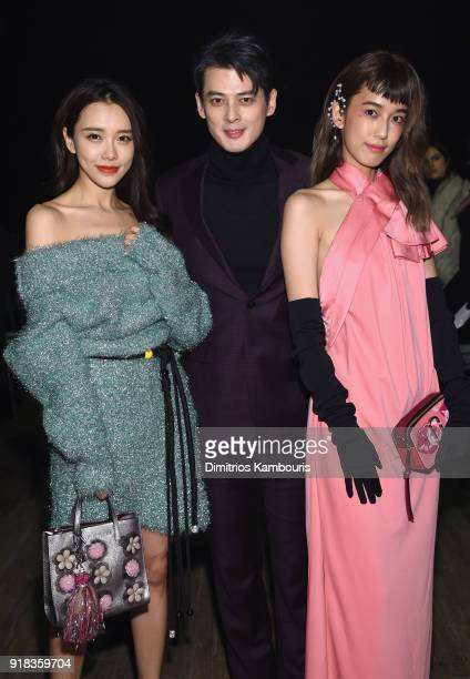 Huang Yilin Dylan Kuo and Nini Chen attend the Marc Jacobs Fall 2018 Show at Park Avenue Armory on February 14 2018 in New York City