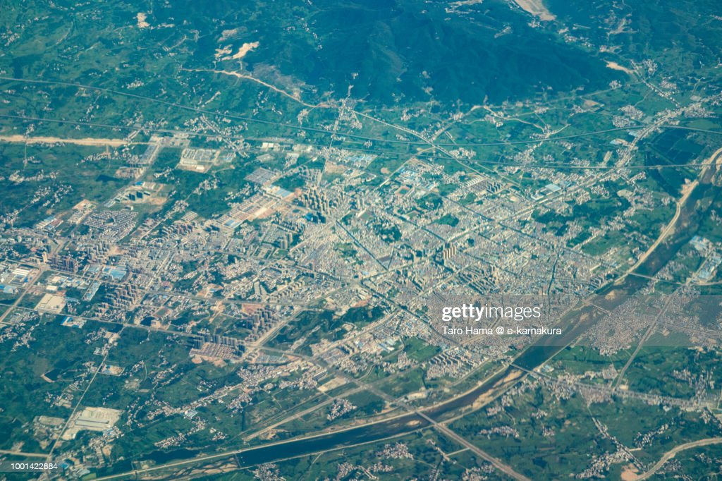 Huanggang City in Hubei Province in China daytime aerial view from airplane : Stock-Foto