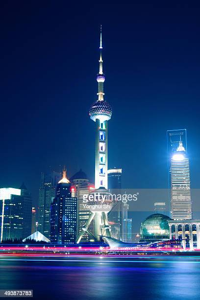 Huangpu River and Pudong skyline at night in Shanghai.