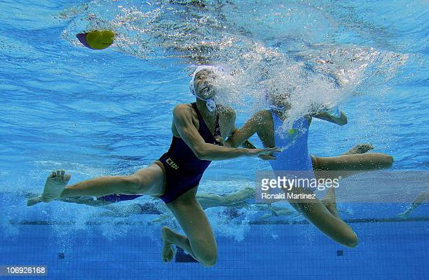 Huanhuan Ma of China struggles with Anna Zubkova of Kazakhstan in the Women's Water Polo during day five of the 16th Asian Games Guangzhou 2010 at...