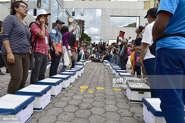 Huaorani natives and Yasunidos ecologist group activists arrive in Quito on April 12 2014 at the National Electoral Council to leave the signatures...