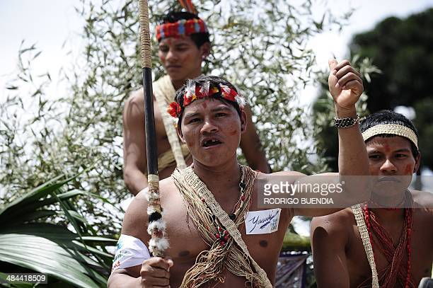 Huaorani natives and Yasunidos ecologist group activists march in Quito on April 12 2014 toward the National Electoral Council to leave the...