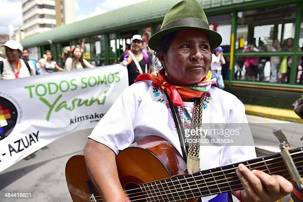 Huaorani natives and Yasunidos ecologist group activists march in Quito on April 12, 2014 toward the National Electoral Council to leave the...