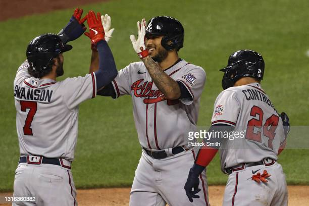 Huascar Ynoa of the Atlanta Braves celebrates with teammate Dansby Swanson after hitting a grand slam home run against the Washington Nationals...