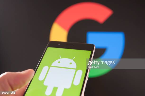 A Huawei Andoir phone is seen with a Google logo in the background in this photo illustration on February 1 2018