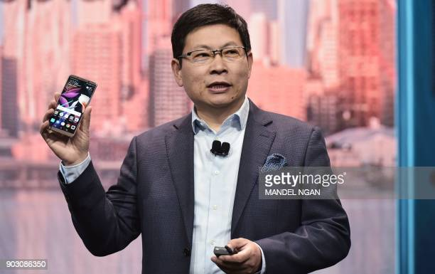 Huawei CEO Richard Yu speaks about the Mate 10 Pro phone during a keynote address during CES 2018 in Las Vegas on January 9 2018 / AFP PHOTO / MANDEL...