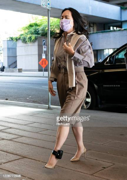 Huawei CFO Meng Wanzhou walks into BC Supreme Court to resume her fight against extradition to the United States on September 28, 2020 in Vancouver,...