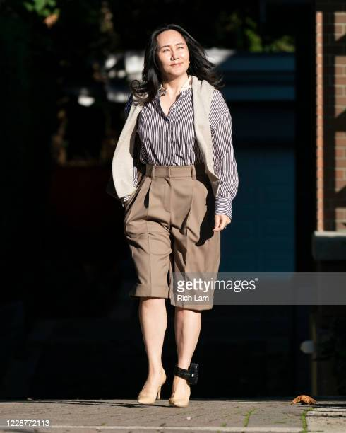 Huawei CFO Meng Wanzhou walks to her car as she leaves her home for the resumption of her continued fight against extradition to the United States at...