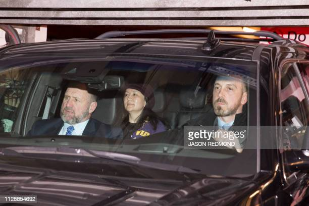 Huawei Chief Financial Officer Meng Wanzhou arrives with a security detail at the British Columbia Supreme Court in Vancouver on March 6 2019 Meng...