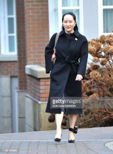Huawei chief financial officer Meng Wanzhou leaves her Vancouver home for an extradition hearing in British Columbia Supreme Court, on January 21,...