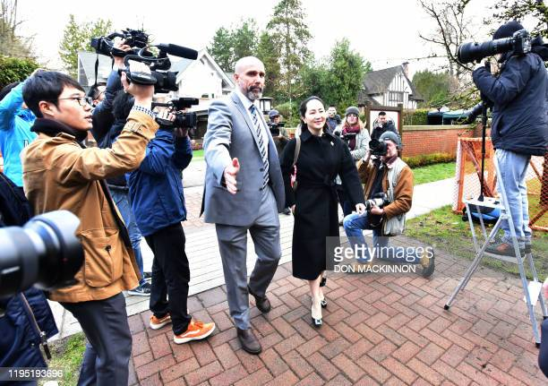 Huawei chief financial officer Meng Wanzhou leaves her Vancouver home with her security detail for an extradition hearing in British Columbia Supreme...