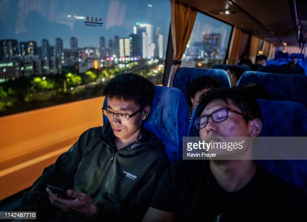 Huawei employees ride the bus home at the end of the workday from the company's Bantian campus on April 26 2019 in Shenzhen China Huawei is Chinas...