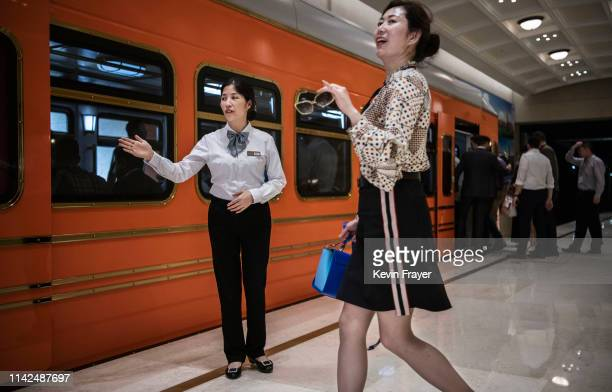 Huawei hostess guides passengers to a train used by employees clients and visitors at 'Paris Station' of the new sprawling 'Ox Horn' Research and...