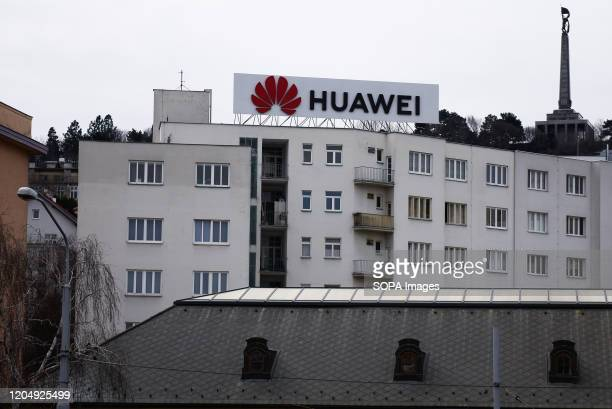 Huawei logo is pictured on the top of a building