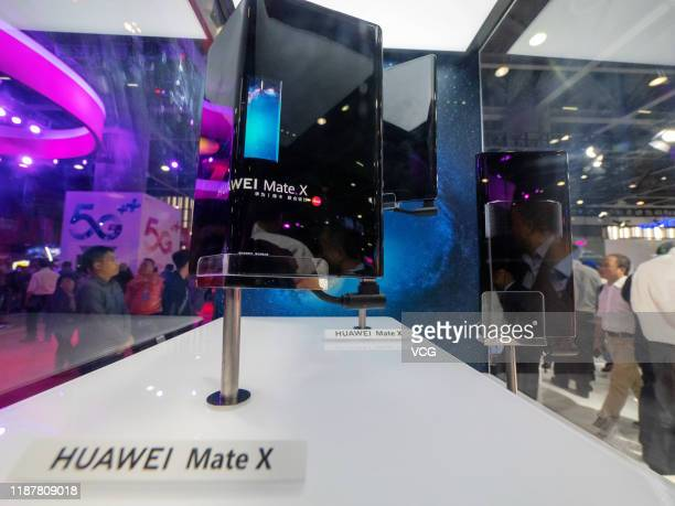 Huawei Mate X 5G foldable mobile phone is on display during China Mobile Global Partners Conference 2019 at Poly World Trade Center Expo on November...
