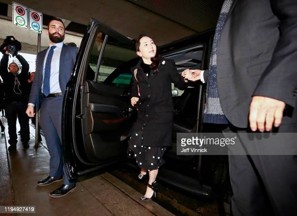 Huawei Technologies Chief Financial Officer Meng Wanzhou exits her vehicle as she arrives at her court appearance on the first day of her extradition...