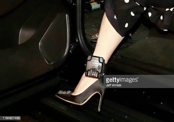 Huawei Technologies Chief Financial Officer Meng Wanzhou wears a GPS ankle bracelet as she exits her vehicle as she arrives at her court appearance...