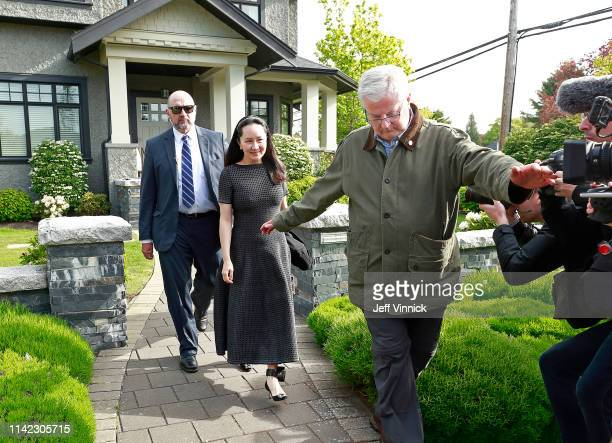 Huawei Technologies Chief Financial Officer Meng Wanzhou wears an electronic monitoring device on her ankle as she is escorted by security from her...