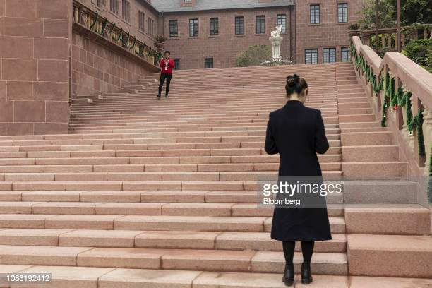 Huawei Technologies Co employees ascend and descend a flight of steps at the company's campus in Dongguan China on Tuesday Jan 15 2019 Ren Zhengfei...