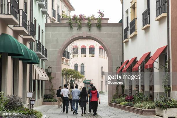 Huawei Technologies Co employees walk through an area known as Granada at the company's campus in Dongguan China on Tuesday Jan 15 2019 Ren Zhengfei...
