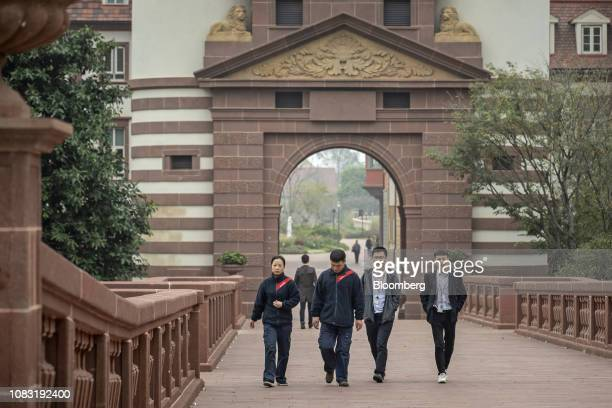 Huawei Technologies Co employees walk through the company's campus in Dongguan China on Tuesday Jan 15 2019 Ren Zhengfei the billionaire founder...