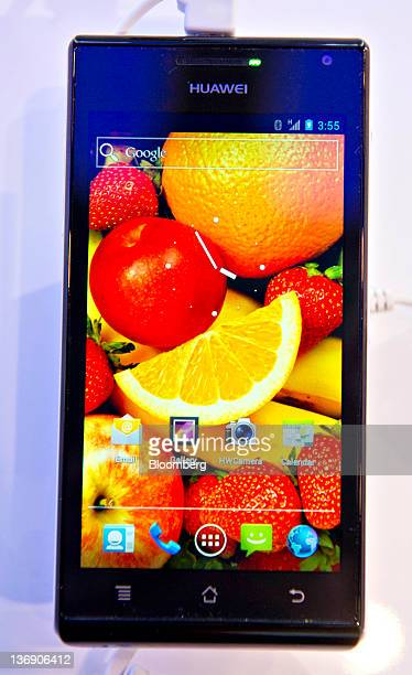 A Huawei Technologies Co Ltd Ascend P1 S smart phone powered by Android 40 and claiming the title of slimmest smart phone at 668mm thick sits on...