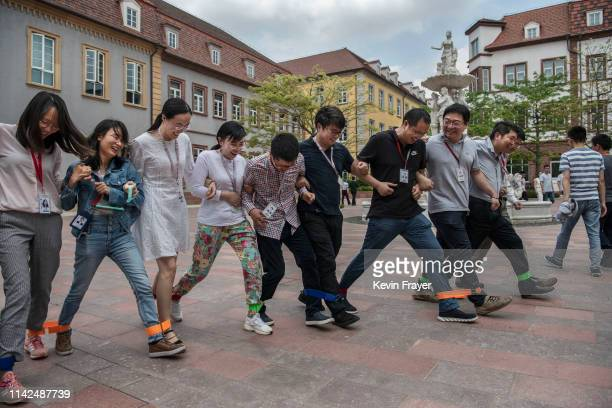Huawei workers play a 'team building' game at the end of the lunch break at the new sprawling 'Ox Horn' Research and Development campus on April 24...