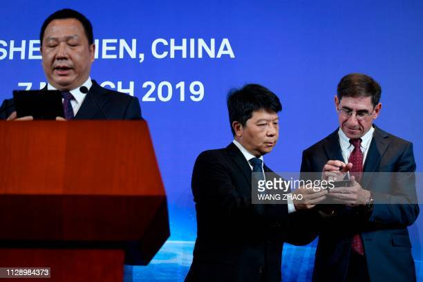 Huawei's rotating chairman Guo Ping and Glen Nager lead counsel and partner at Jones Day attend a press conference in Shenzhen China's Guangdong...