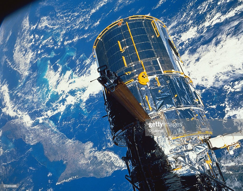 Hubble Space Telescope Over the Earth : Stock Photo