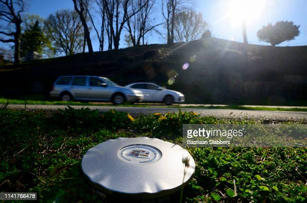 Hubcap left on side of road as traffic rushes past