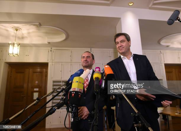 Hubert Aiwanger leader of the Bavarian Free Voters party and Markus Soeder Bavaria's State Premier of the conservative Christian Social Union speak...
